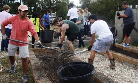 The community came together at the Sustainability Center to clean up the garden.