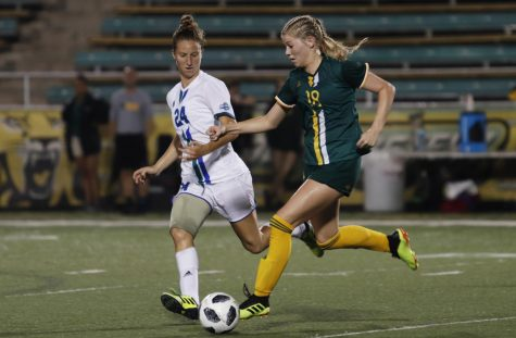 Jamie Raines, a freshman midfielder, chases down the ball.