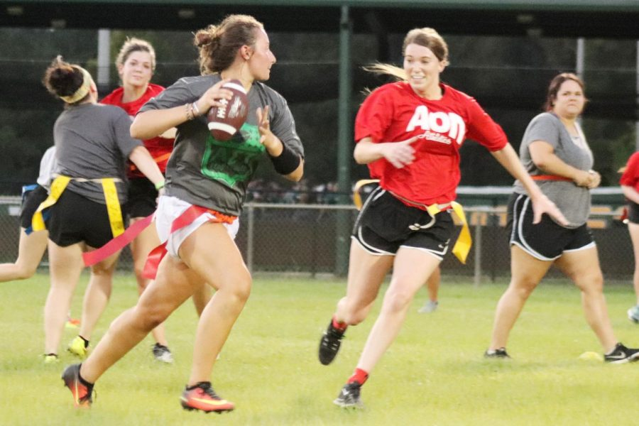 Morgan Foret, Alpha Sigma Tau quarterback, rolls out to the right in her team's flag football match.