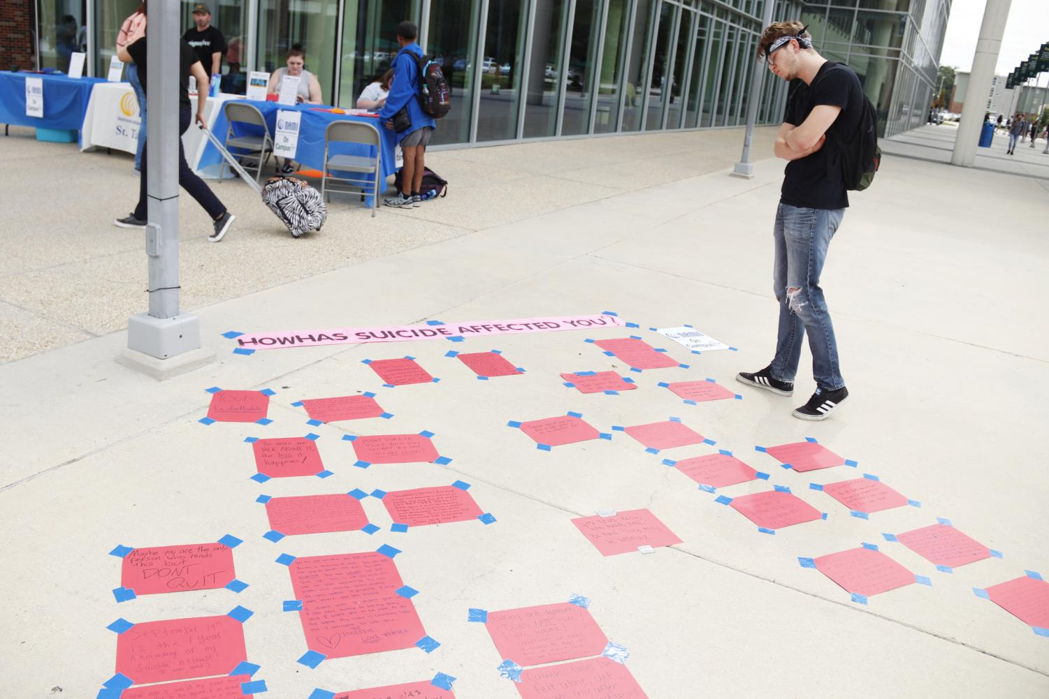 Dozens of students participated in NAMI's suicide awareness exhibit this past Tuesday.