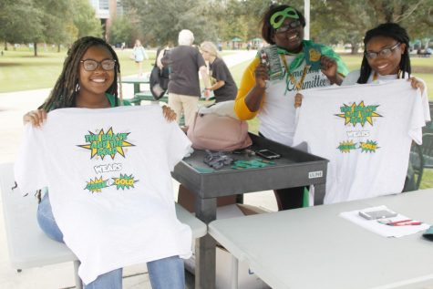 Members of the Homecoming Committee Ricketta Griffin, a junior social work major, Georgette Williams, a senior general studies major, and Mi'Yana Solomon, a sophomore nursing major, gave out T-shirts to students today as a part of Homecoming Week.