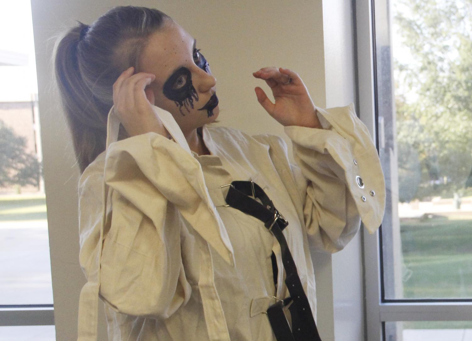 """Stashia Liegl, a freshman psychology major, dresses as an asylum patient in the""""Haunted House"""" put on by Campus Activities Board."""