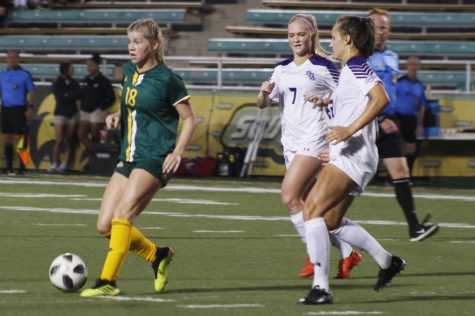 Jamie Raines, a freshman midfielder, takes the ball down the field.
