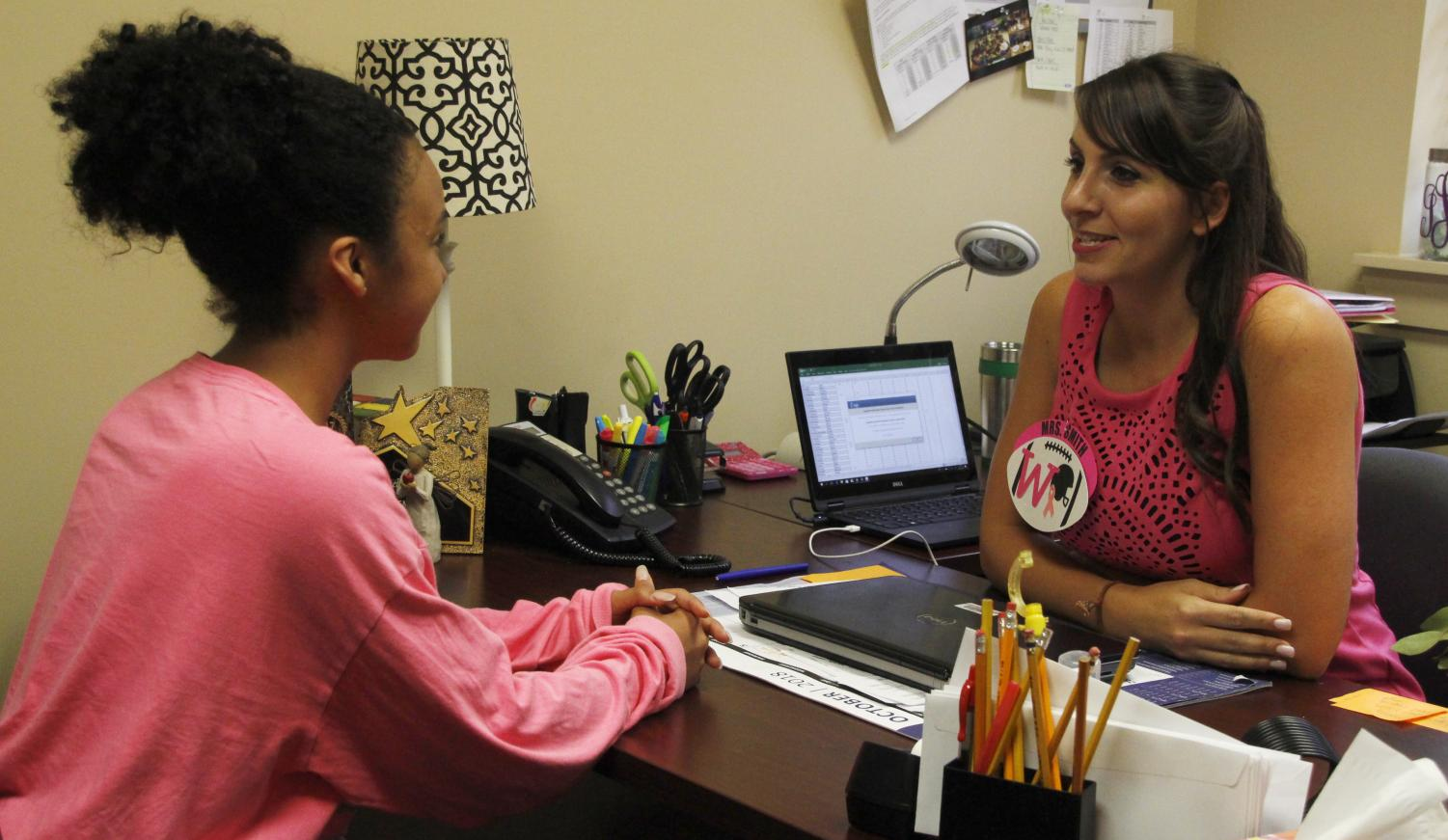 2018 Young Alumnus of the Year Joni Smith speaks with one of the students at Westside Junior High in her role as administrative assistant. Smith was also named the 2017 Louisiana State Teacher of the Year.