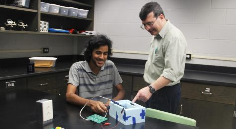 Damodar Dahal, a senior majoring in mathematics, physics and computer science, and Professor of Physics Dr. Gerard Blanchard work on Project ROOMIE 1.