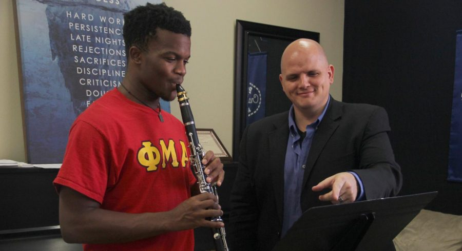Instructor of Clarinet and Assistant Director of Bands Victor Drescher shows a Phi Mu Alpha student the proper clarinet technique. Drescher has taught at the university since 2013.