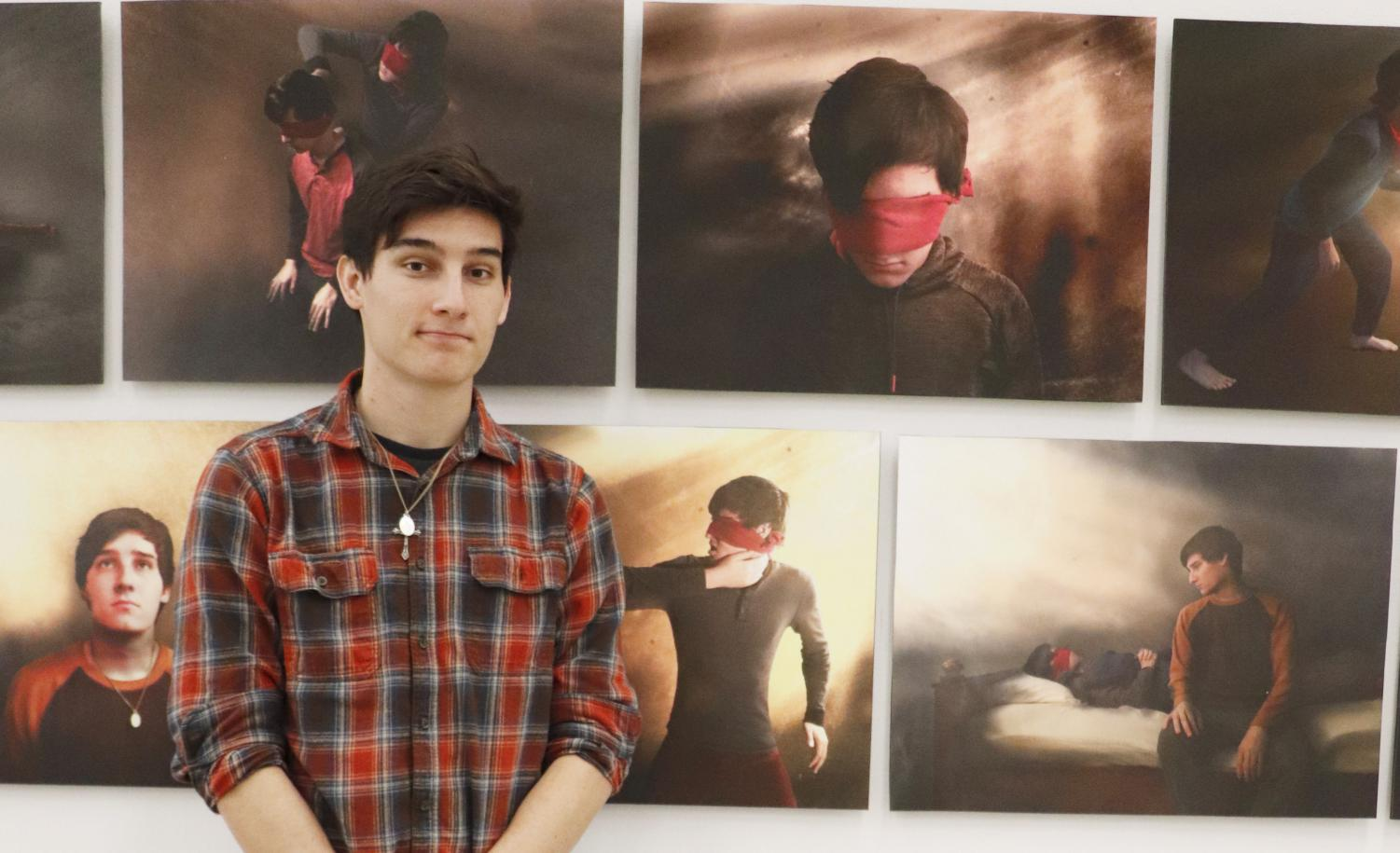 "Senior art major Heath Feraci displays his artwork in the Contemporary Art Gallery for the ""Fall 2018 Senior Exhibition."""
