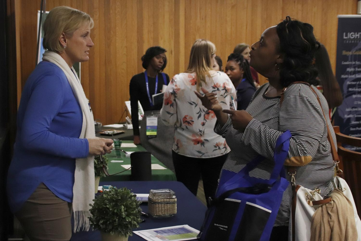 Sherry Chaney, a licensed clinical social worker for Lifeline Behavioral Health, left, speaks with other professionals in the field at the second annual Terrell Conference to build a community. This year's conference included more time for attendees to network.