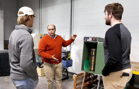 Dr. Mohammed Zeidan, assistant professor of engineering technology, shows William Maley, a junior engineering technology major, and Christopher LeSage, a senior engineering technology major, the equipment used in the construction lab. Two students in the engineering technology program will receive a scholarship funded by a grant from Terracon.