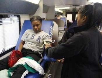 Rwanda Breaux, a sophomore health systems management major, gave blood during CAB's blood drive.
