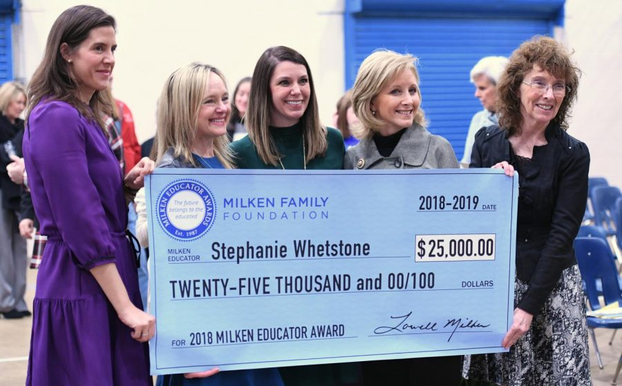 Hannah Dietsch, Louisiana assistant superintendent, Joni Lacy, talent project director for the Louisiana Department of Education, Stephanie Whetstone, Milken Educator Award recipient, Donna Edwards, Louisiana first lady, and Dr. Jane Foley, senior vice president of the Milken Educator Awards, pose at the presentation of the oversized $25,000 check to Whetstone.