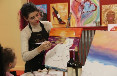 Kendall Alvis, an instructor at Painting with a Twist, teaches a class on painting a mermaid and a beach scene. Along with the Hammond Regional Arts Center and the Columbia Theatre for the Performing Arts, Painting with a Twist is a venue in Hammond that can mingle romance and art.