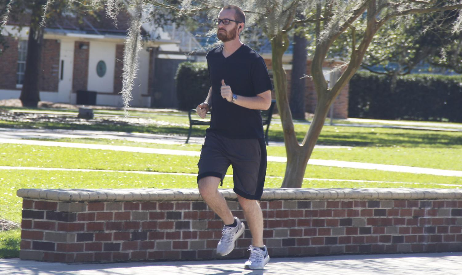 Andrew Belgard, a senior chemistry major, goes for an afternoon run in Friendship Circle. Exercise like running can boost mood due to an increase in endorphin levels along with the muscle workout.