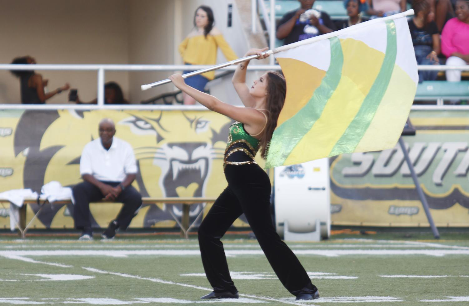"Members of the ""Spirit of the Southland"" color guard perform at home football games in the Strawberry Stadium. Other performances include Lionpawlooza at ""Hot August Night"" and ""Strawberry Jam."""