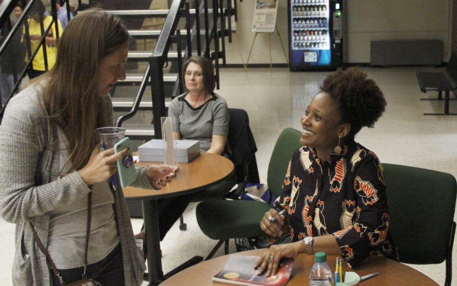 Tracy K. Smith, United States Poet Laureate, signs her book