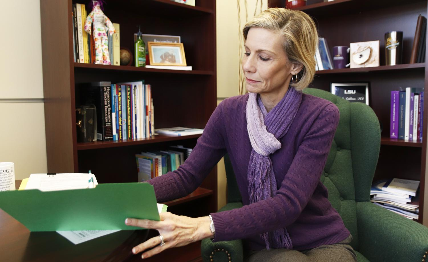 Paula Calderon, dean of the College of Education, reviews files in her office. She and Payton Bryant, university alumna and a teacher at Luling Elementary School, went to Washington, D.C. for discussions about preparing teachers for their career.
