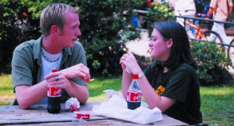Two students talk to each other in SGA Park in 2001. Ever since Christine Bentley, associate professor of general studies, graduated from the university in 1971, the student life on campus has changed tremendously. Dr. Rosemary Clark, instructor of biological sciences, has seen some cultural similarities and differences from 10 years ago.  File Photo/The Lion's Roar