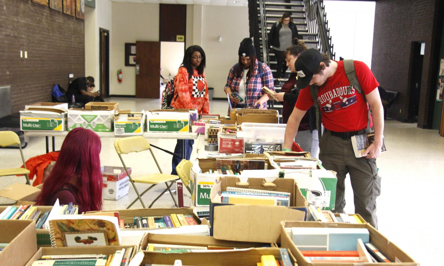 Students browse through the selection of books Tuesday afternoon. The Sigma Tau Delta book sale will be held from Mar. 12-13.
