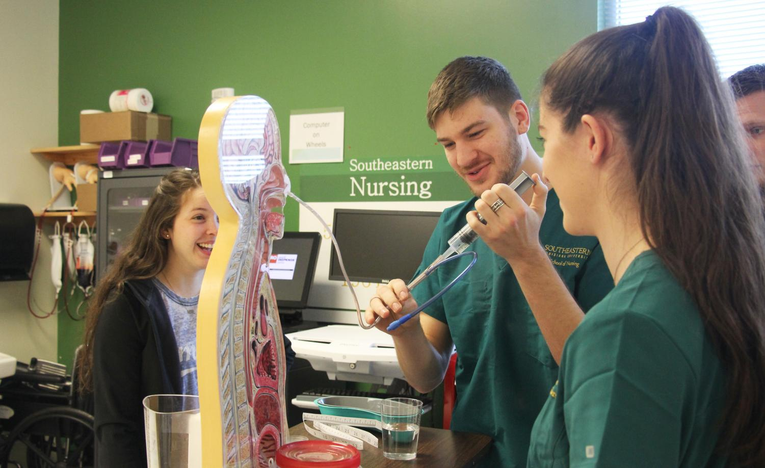 Connor Haag, a nursing major, practices a skill he and his classmates learned for a class led by Michelle Reed, an instructor of nursing. Through on-hands activities such as this, the College of Nursing aims to help prepare students for their profession.