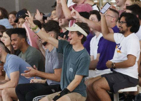 Members of Greek life cheer on their teams. Greek organizations compete in the annual Greek Week through activities like dodgeball and a step show.
