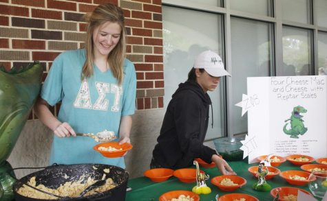 Victoria Reid, a member of Alpha Sigma Tau on the Rugrats team, spoons pastalaya into bowls. Her team placed third in the