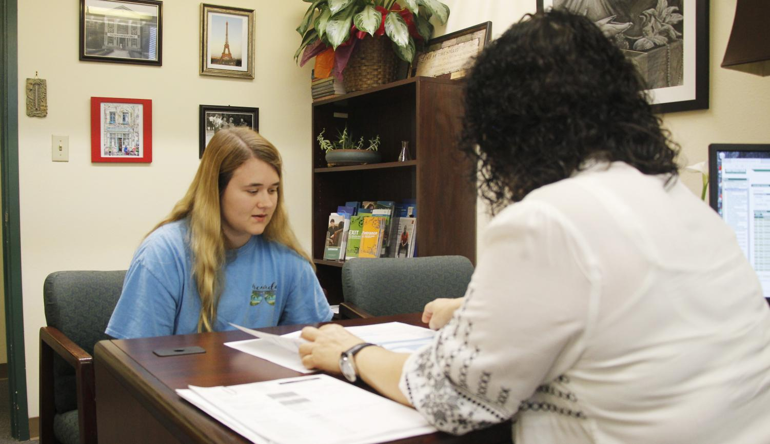 Lindsey Thompson, a sophomore nursing major, speaks with a financial aid counselor about available aid. Students can call or stop by the Office of Financial Aid to learn more about paying for school.