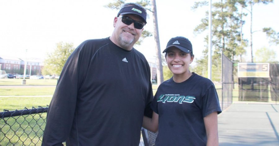 Jason Hayes, head coach of tennis, left, and Katya Cornejo, a sophomore international student on the tennis team, right, take a break during practice. Hayes has been coaching tennis for 16 years and has eight Coach of the Year Awards.
