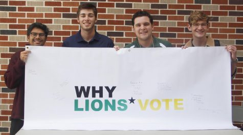 The Student Government Association used a sheet sign and beads to promote people to vote in the upcoming election on Saturday.