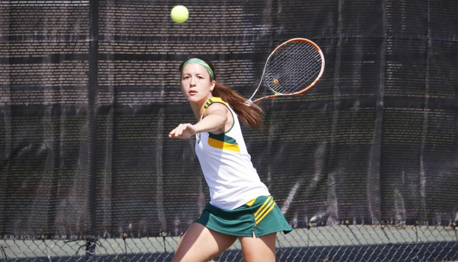Ceci Mercier, a senior on the tennis team, watches the ball in a match against McNeese State University. Daniel Anders, coach of the Tennis Club, looks to build a sports club for tennis on campus.