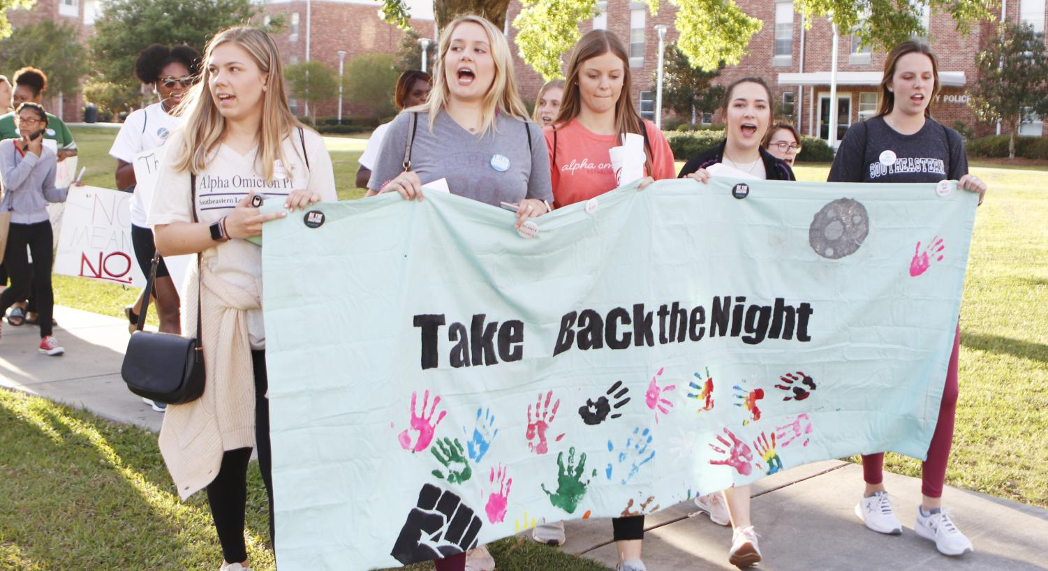 "For ""Take Back the Night Rally,"" students marched with posters around campus and chanted to raise awareness about sexual assault. Scheduled during Sexual Assault Awareness Month, the march is part of a national campaign to engage students and educate them on the issue."