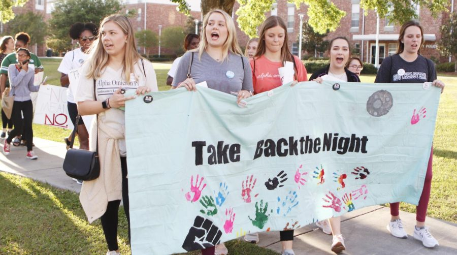 Students+carry+signs+as+they+march+around+campus+for+%22Take+Back+the+Night+Rally.%22+The+event+aimed+to+bring+more+awareness+to+sexual+assault+on+college+campuses.+