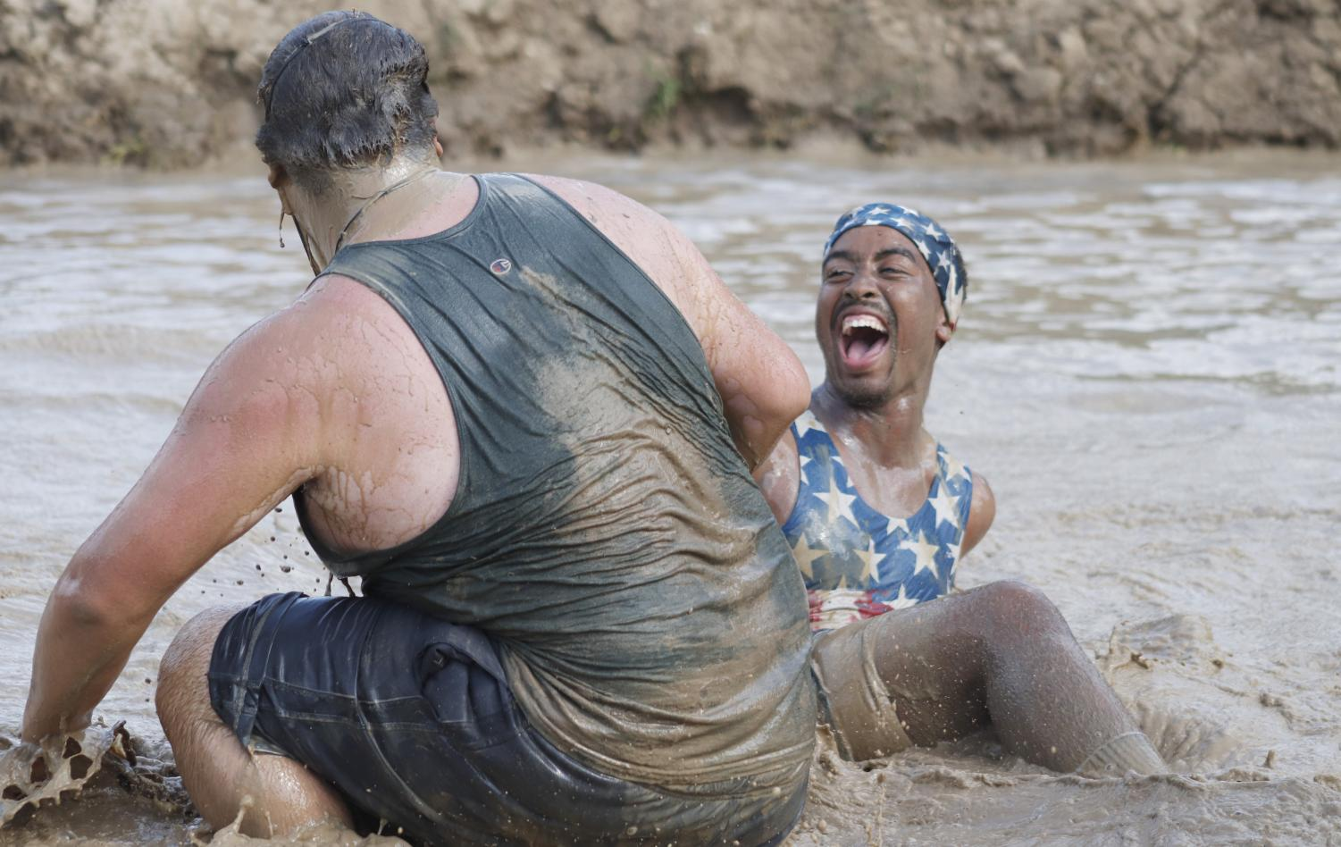 """Students enjoy themselves and bond while participating in """"Swamp Bowl."""" The mud volleyball tournament is hosted each year outside the Pennington Student Activity Center."""