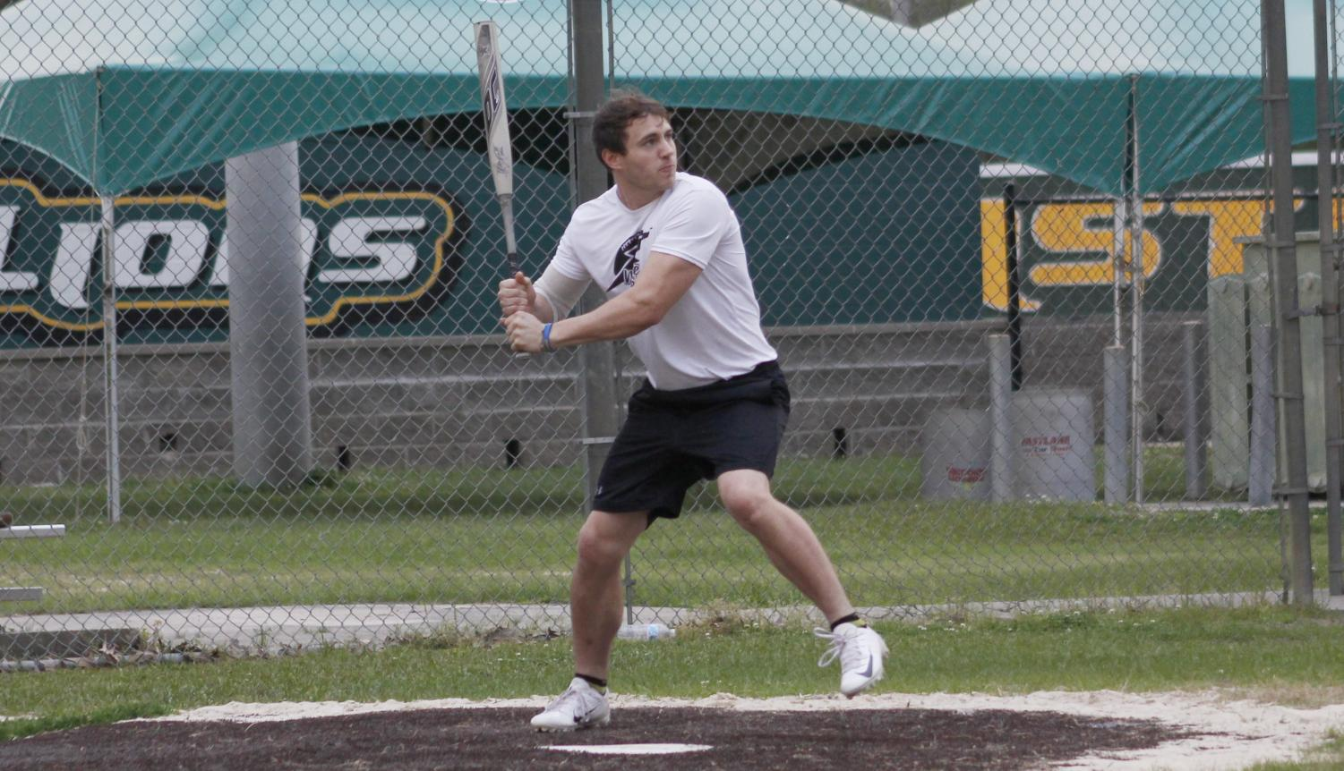 A player from White Lightning gets ready to hit the ball. Intramural sports offer several options for students who want to play the game.
