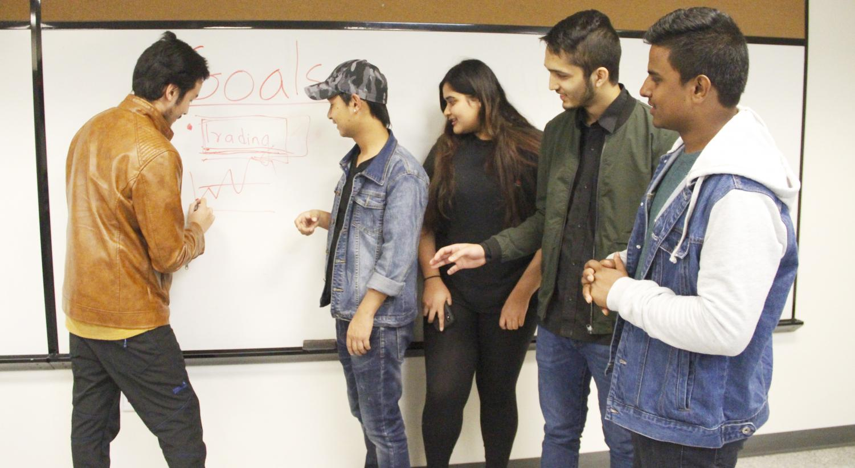 Prashant Basnet, a sophomore informational technology major, talks about goals with fellow sophomores Shawn Lama, a computer science and mathematics double major, Nikita Thapaliya, Alish Dhamala and Bishwa Bista, computer science majors.