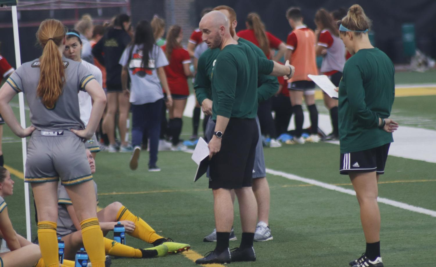 Christopher McBride, head coach of soccer, talks to his players before a game. McBride coached the Lady Lions to a 7-7-4 record in the 2018 season.  McBride is a native of Scotland, and he learned the fundamentals of soccer from his father.
