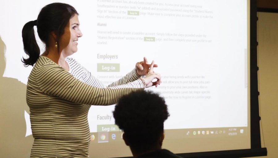 Kim Readlinger, career counselor for the Office of Career Services, talks to students about the importance of being prepared for post-graduation opportunities. Students, alumni and professors may find that getting into the job market takes hard work.