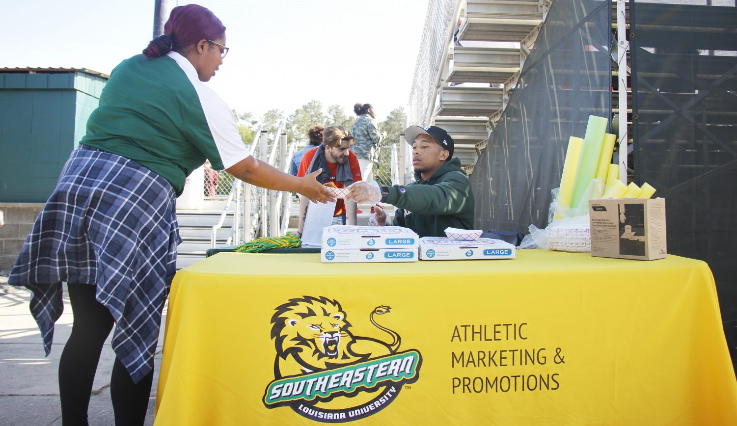 """Flood the Field,"" a promotion event for the Lady Lions softball game, is an athletics marketing classic. With events like these, the first students to arrive at the game get free pizza and a T-shirt. With proper advertising and promotions, athletics aims to engage with both fans and people who are not interested in sports."