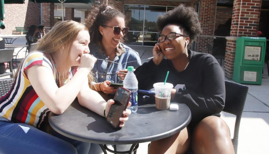 Victoria Wade, a freshman biological sciences major, left, Abigail Street, a junior English major, middle, and Karin Perry, a freshman criminal justice major, right, listen to music through earphones. All three appreciate gospel music.