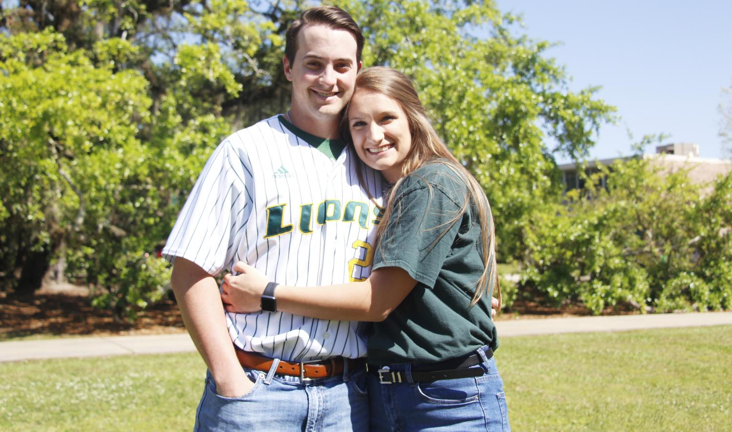 Carlisle Koestler, a senior pitcher, and Jenna Bordelon, a junior nursing major, pose for a picture in Friendship Circle. They   began dating about two years ago and have managed the time commitments of athletics.