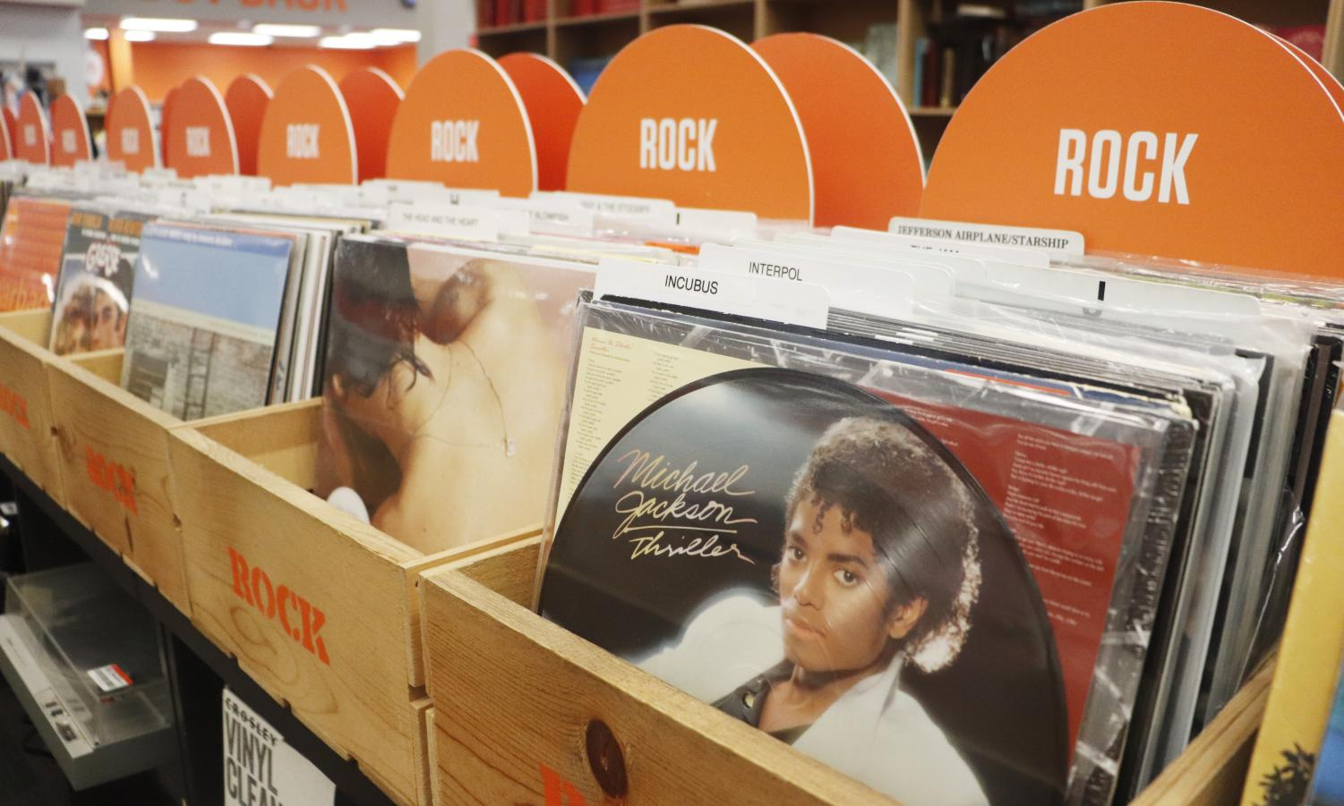 2nd and Charles has a vinyl section, which includes turn tables, for sale. Vinyl's popularity grew in part for its historical value.