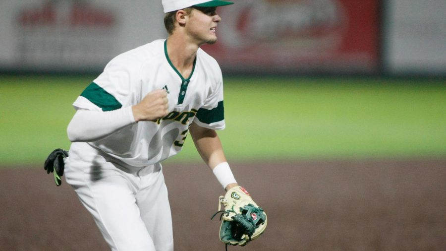 Trey Harrington, a sophomore business administration major, celebrates a good play as the third baseman for the Lions. Harrington began playing baseball as a child and is now following in the footsteps of his father by playing collegiate baseball.