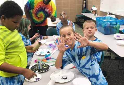 "Children participate in art activities during the ""Roomie's REC Camp."" This year's camp begins on May 28 and will provide children aged 4-12 opportunities to engage in a friendly learning environment."