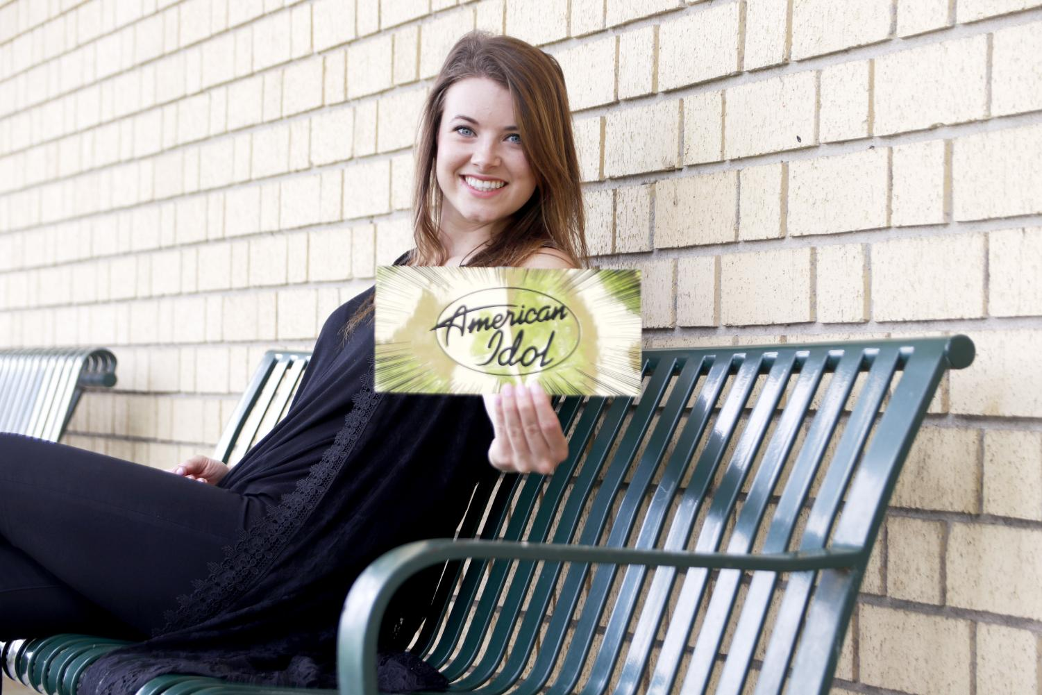 Ashton Gill, a sophomore nursing major, shows off her Golden Ticket from American Idol. Gill auditioned with the to-be title winner Laine Hardy and advanced to Hollywood with her singing skills.