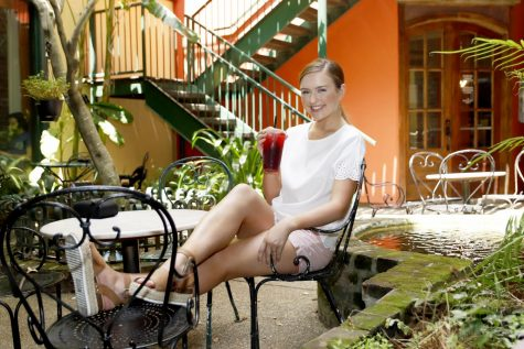 Miss Southeastern Louisiana University Chelsey Blank enjoys an iced rose tea in the courtyard of Courtyard Cafe. The cafe opened in downtown Hammond in 2017.