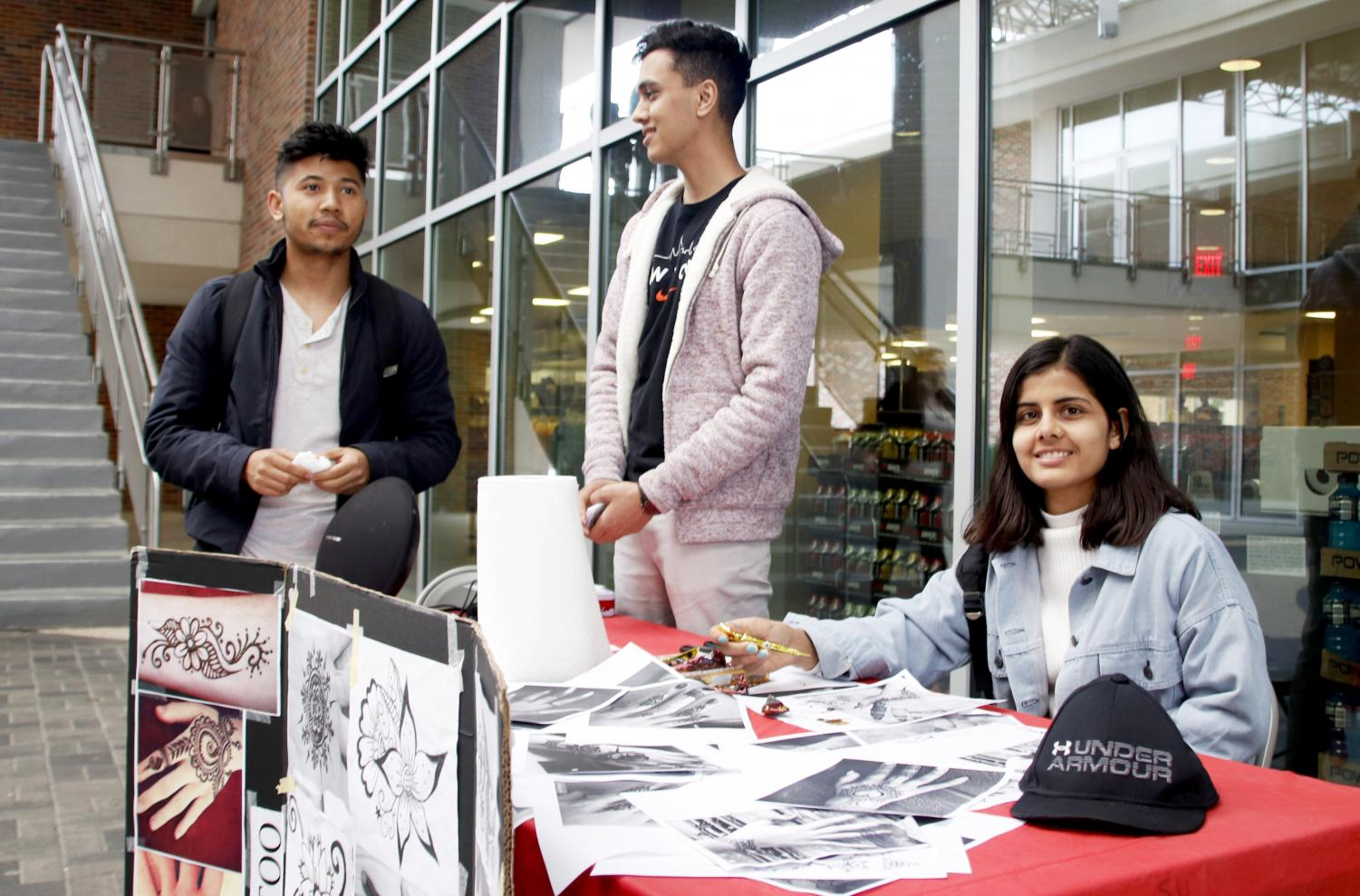 Members of the Nepalese Student Association at Southeastern sell henna tattoos to raise money for their organization. The university has 123 organizations students an join.