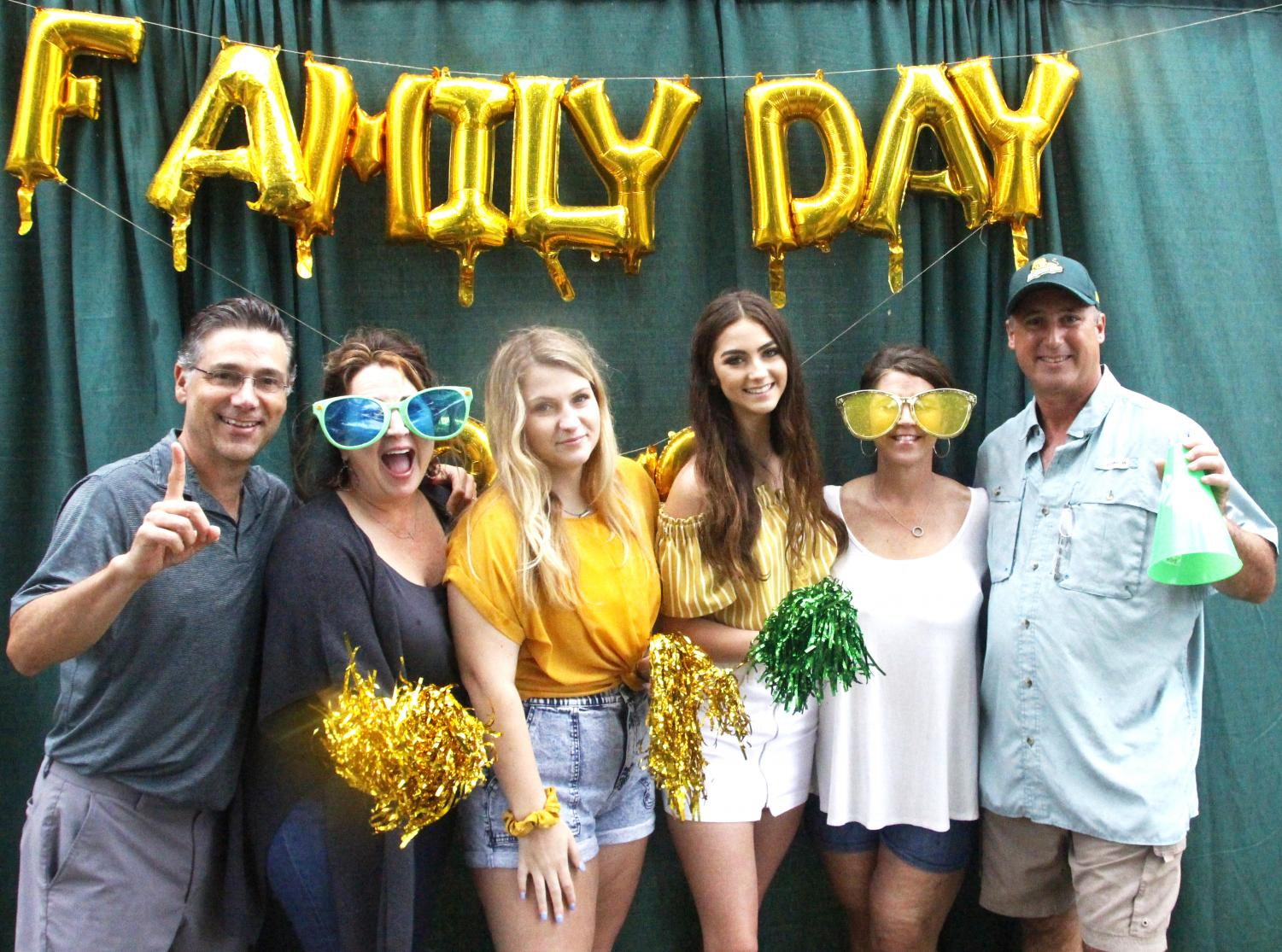 Despite the rainy weather, student and families participated in the Family Day tailgate before the
