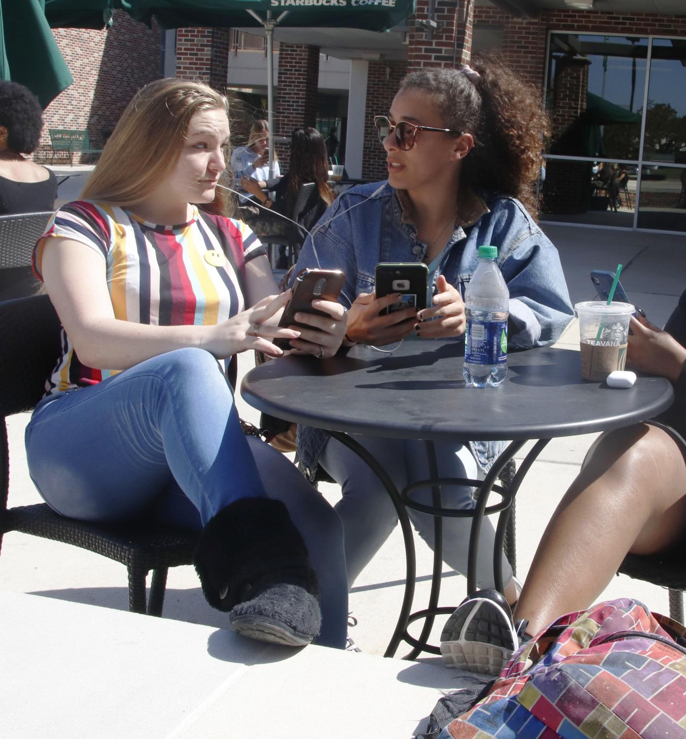 Students share headphones to listen to music. Music is a common study device used by students, but opinions on which music works best differs between people. Research has shown positive outcomes for listening to music while studying.