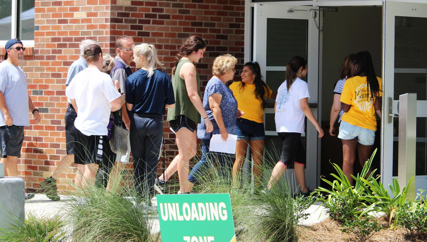 Students line up to get inside their dorms during the Move-in Mane-ia. While some students prefer living on campus, others find it better to commute.