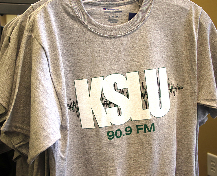 KSLU radio station has started selling merchandise at the University bookstore. Currently, T-shits ranging from sizes small to XL are available for students to buys.