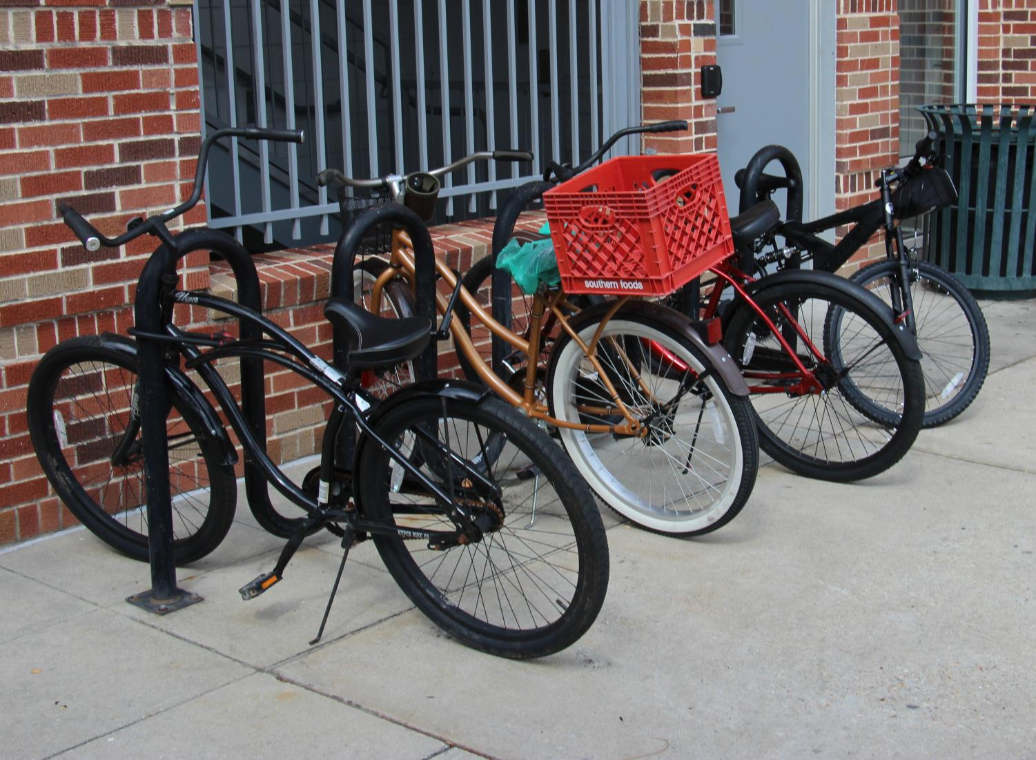 Student's bicycles are chained to a bike rack outside of St. Tammany Residence Hall. To use a bicycle on campus, students must register their bicycle with the Office of Transportation Services.